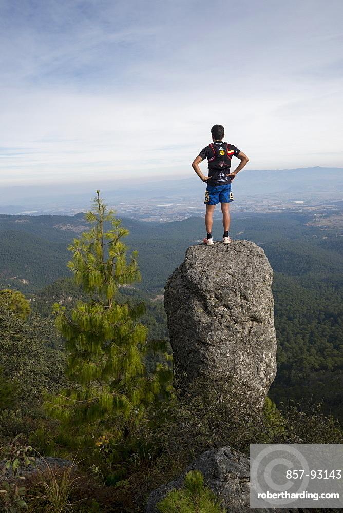 Man Exploring Rancho Santa Elena Standing On Top A Rock In Hidalgo, Mexico