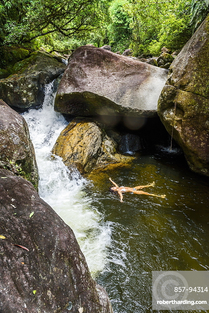 Woman bathing in Pirapetinga River in Serrinha do Alambari, Rio de Janeiro, Brazil