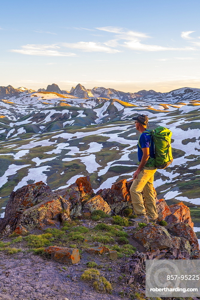 Photograph of single adventurous hiker above Stony Pass near the Grenadiers and the Weminuche Wilderness, Silverton, Colorado, USA