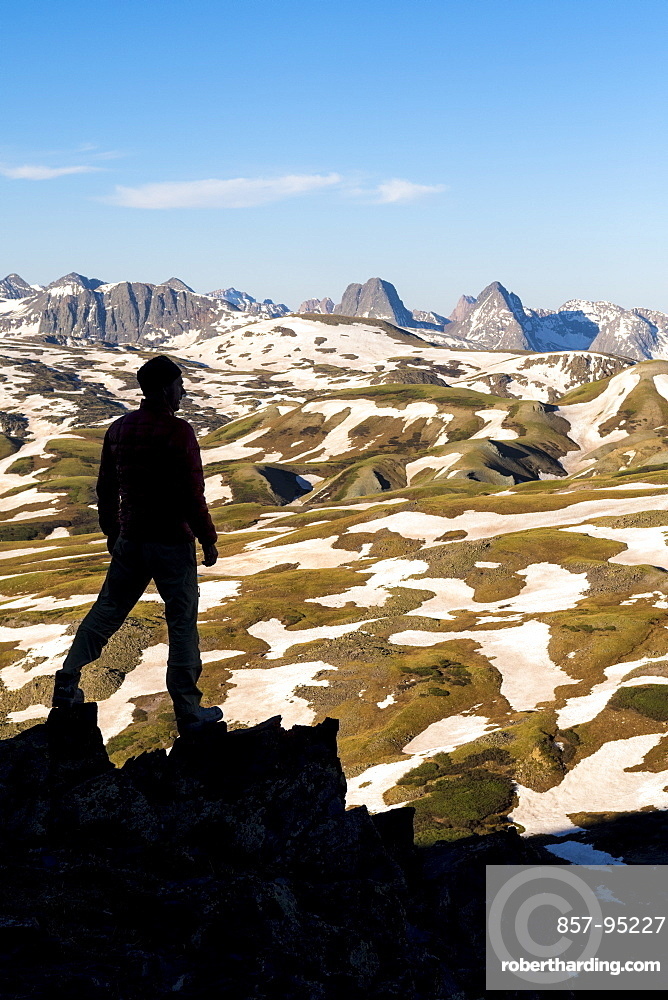 Silhouette of hiker above Stony Pass near the Grenadiers and the Weminuche Wilderness, Silverton, Colorado, USA