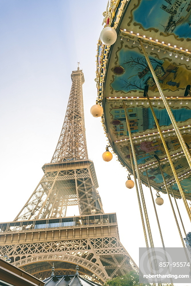 View of the famous Eiffel Tower and carousel in the foreground, Paris, France