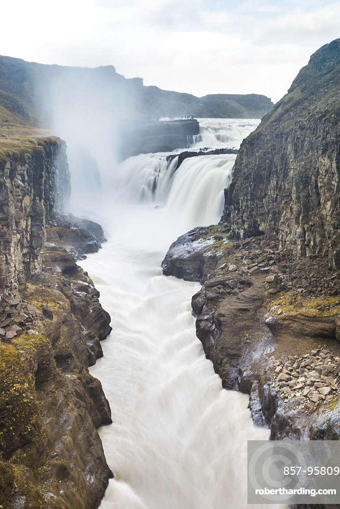 Scenic view of Gulfossi waterfalls flowing through surrounding canyon, Iceland