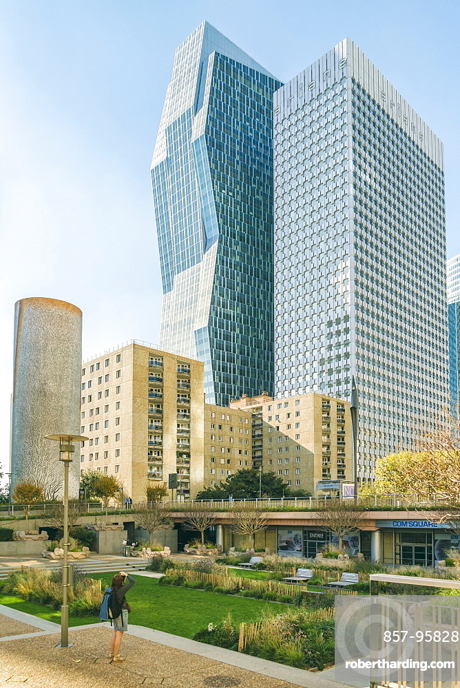 Modern architecture at La Defense district under clear sky, Paris, Ile-de-France, France