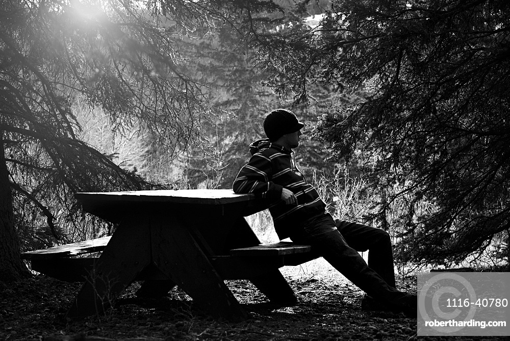 Man Resting On Picnic Table