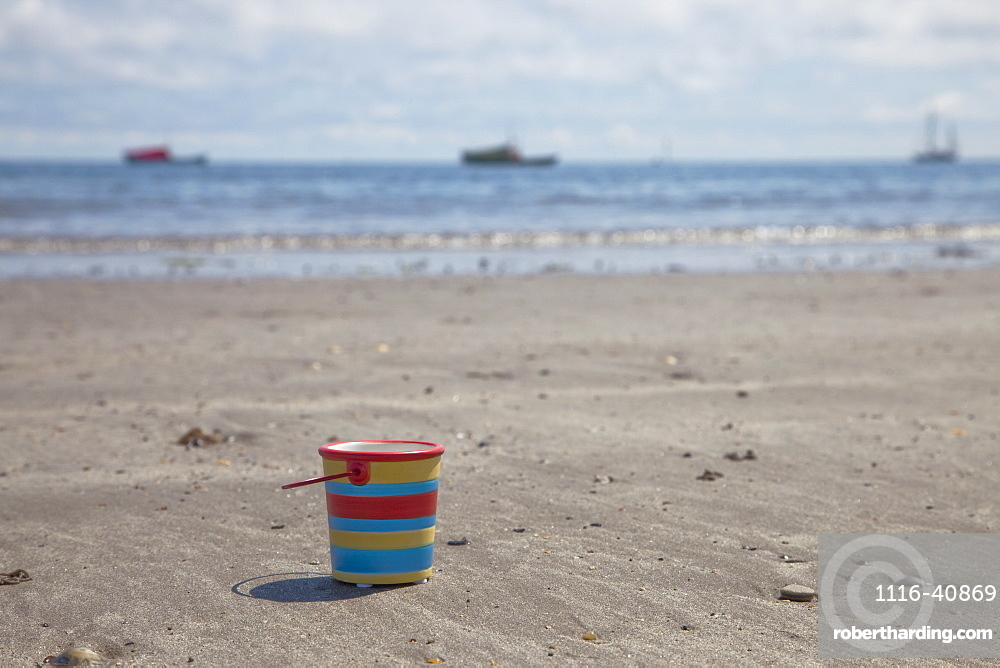 Bucket On The Beach, Northumberland, England