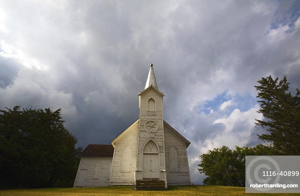 Weathered Church And Dark Skies