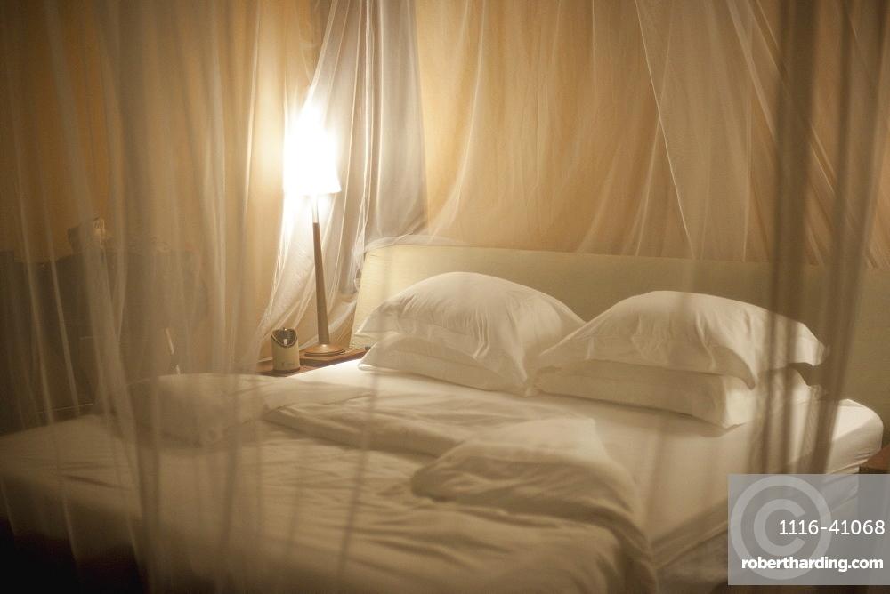 Bedding With Mosquito Netting, Kenya, Africa