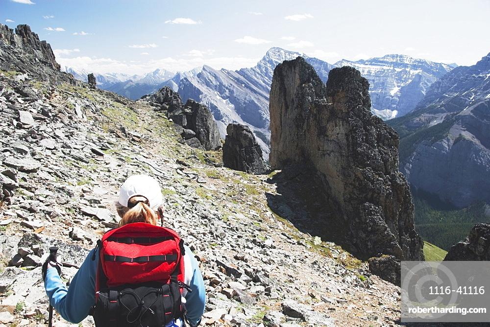 Woman Hiking On A Mountain Trail