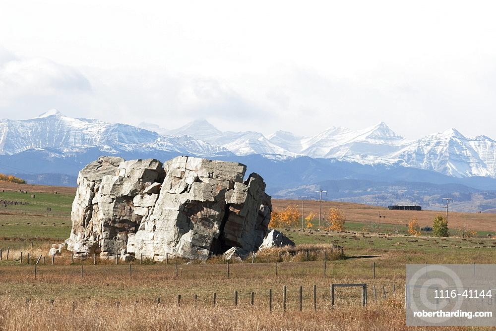 Big Rock And Mountains, Alberta, Canada