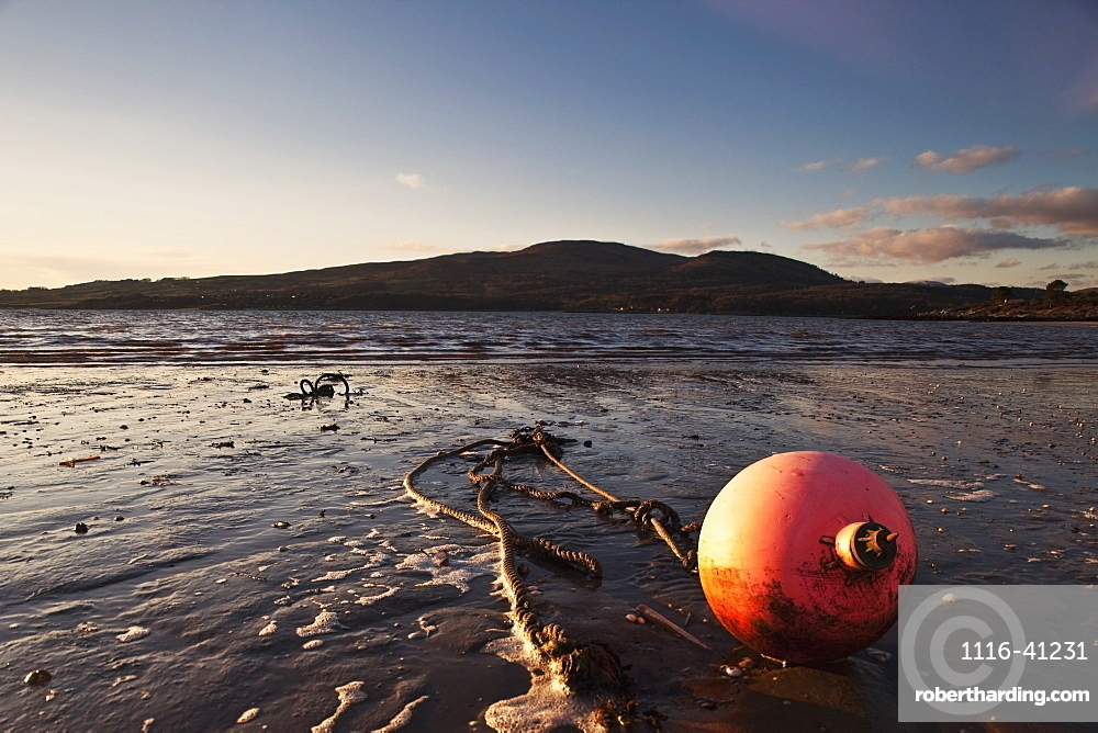 Dumfries, Scotland, A Rope Tied To A Buoy Laying In The Tide On The Shore