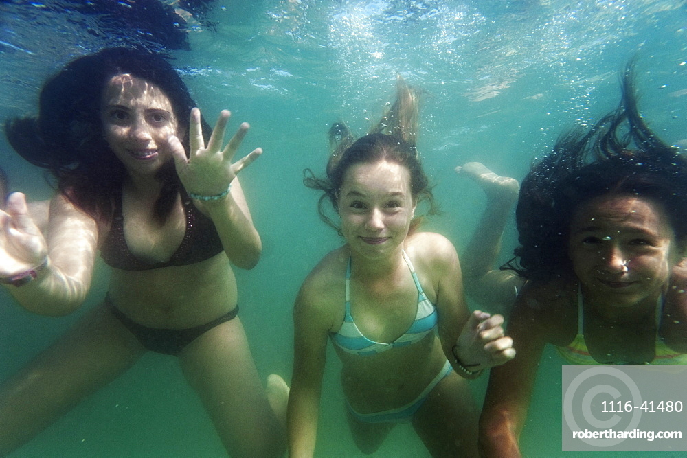 Three Girls Under The Water, Benalmadena Costa, Malaga, Andalusia, Spain