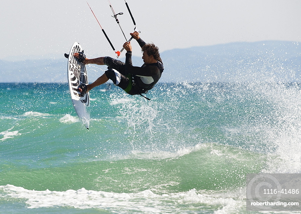A Man Kitesurfing Off Dos Mares Beach In Front Of Hotel Dos Mares, Tarifa, Cadiz, Andalusia, Spain