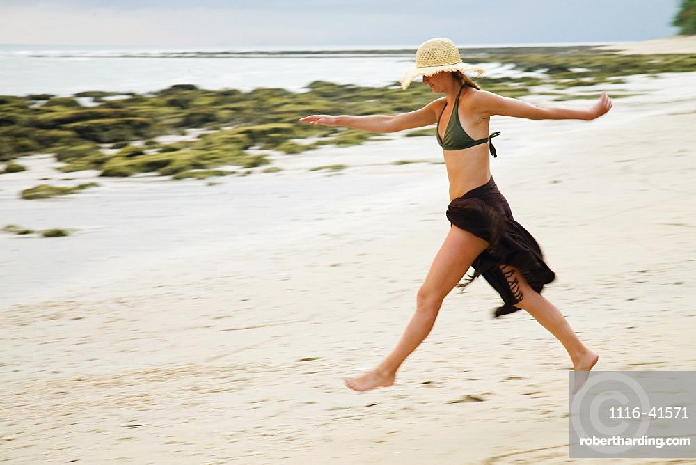 A Woman Tourist Walks On The Beach Of A Tropical Island, Koh Lanta, Thailand