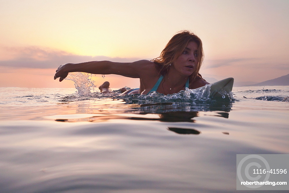 A Woman Paddling On A Surfboard At Sunset, Tarifa, Cadiz, Andalusia, Spain