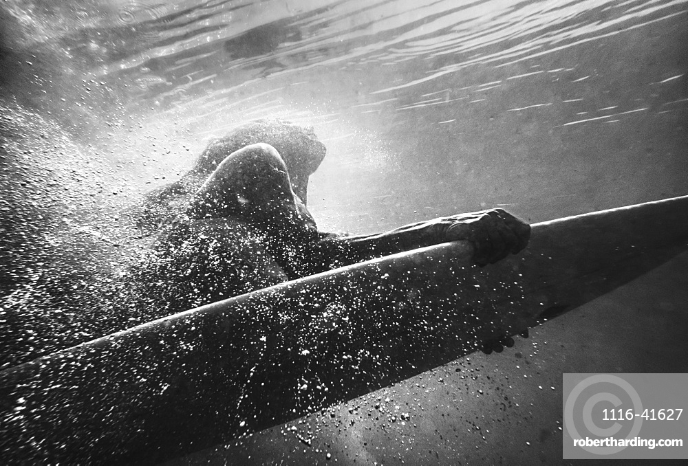 A Woman On A Surfboard Under The Water, Tarifa, Cadiz, Andalusia, Spain