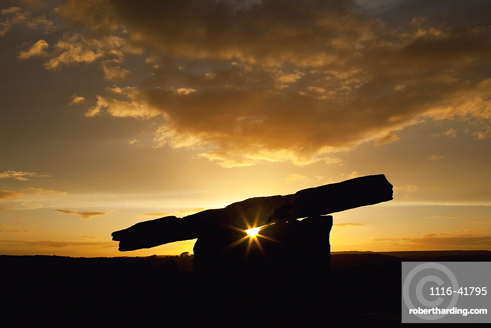 The poulnabrone dolmen at sunset, near ballyvaghan, County clare, ireland