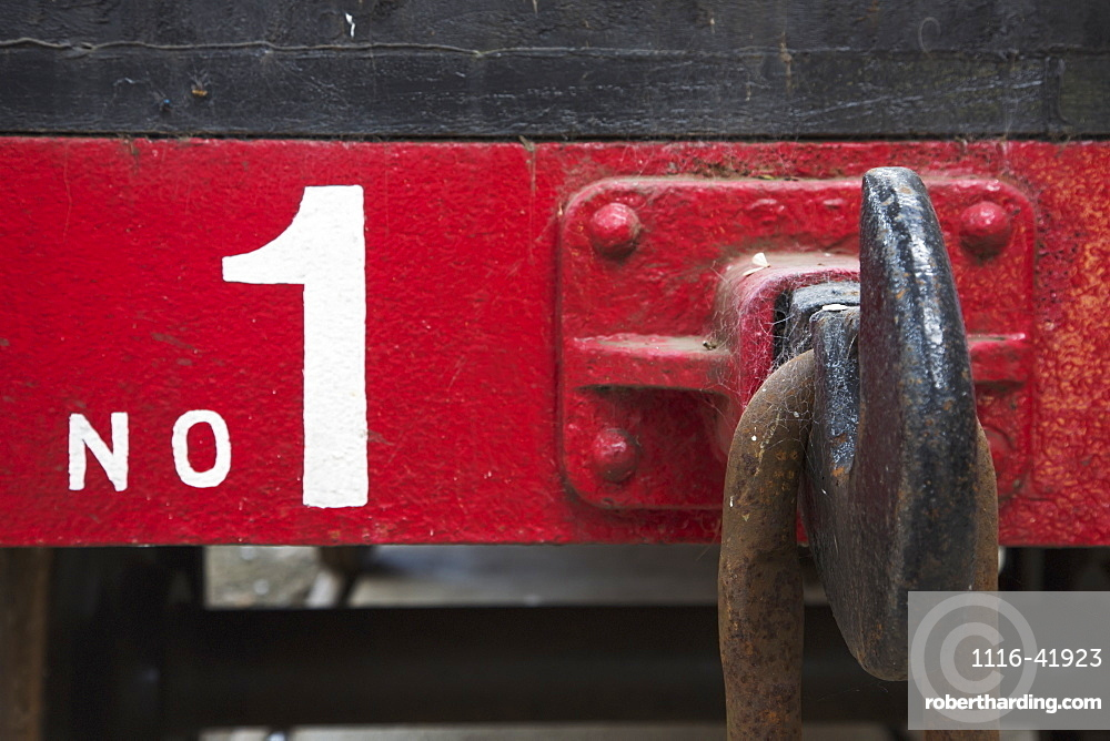 A large metal hook and chain link on the back of a train car labeled number one, Shildon durham england