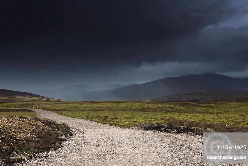 A gravel path under dark storm clouds, Highlands scotland