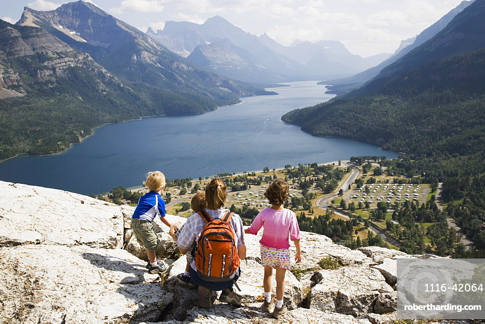 Mother And Children Enjoy View At Waterton Lakes National Park, Alberta Canada