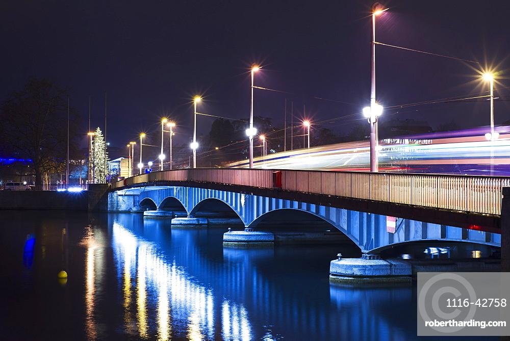 Lights illuminate a bridge over lake zurich at night, Zurich switzerland