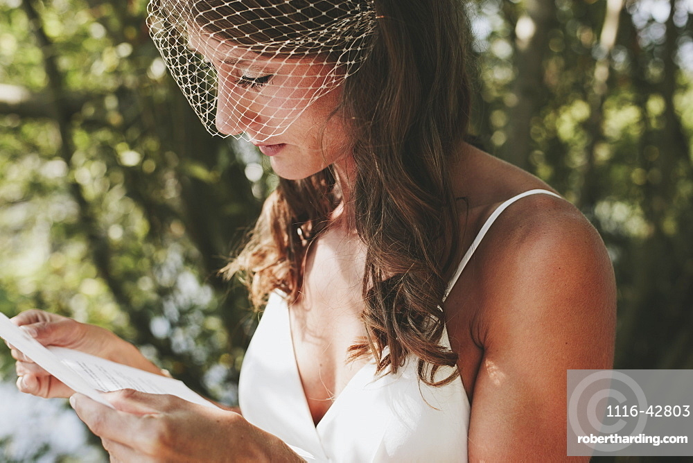 A bride reading from a piece of paper, Kirkland washington united states of america