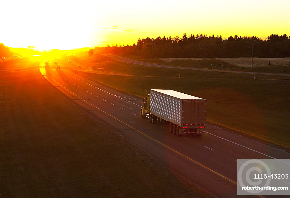 Truck Heading Down A Highway At Sunset, Edmonton, Alberta, Canada