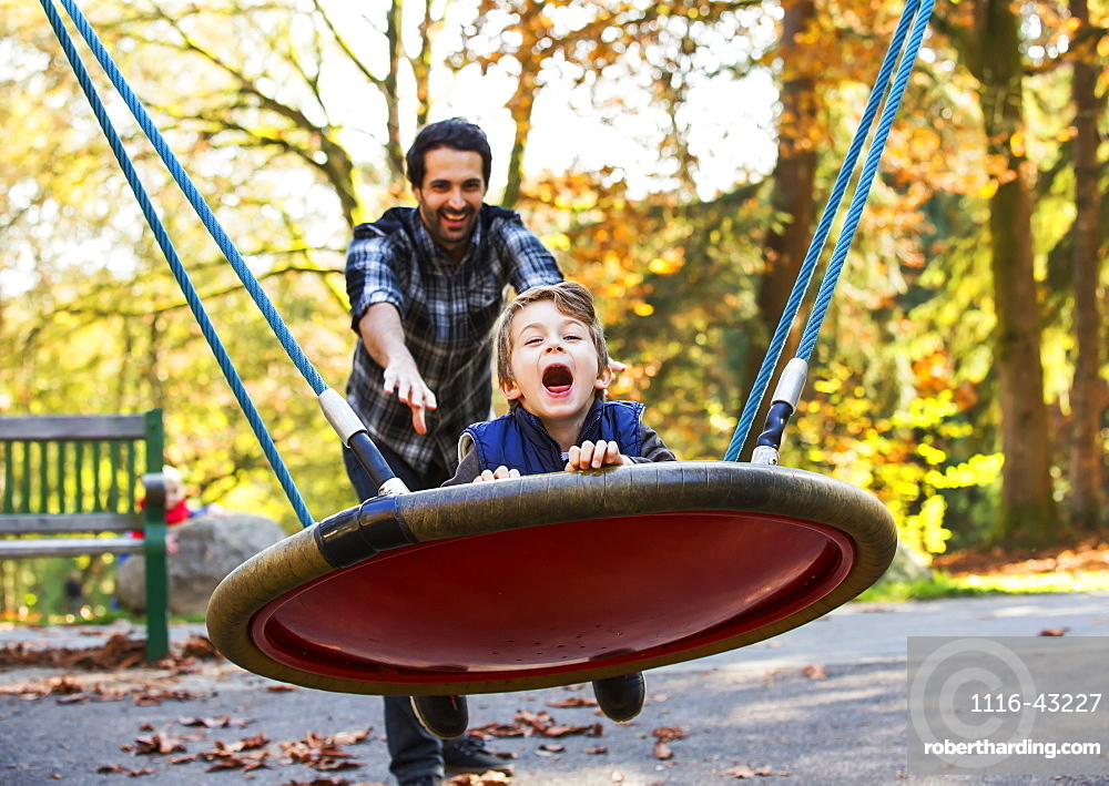 Father And Son Having Fun Together At A Playground, Langley, British Columbia, Canada