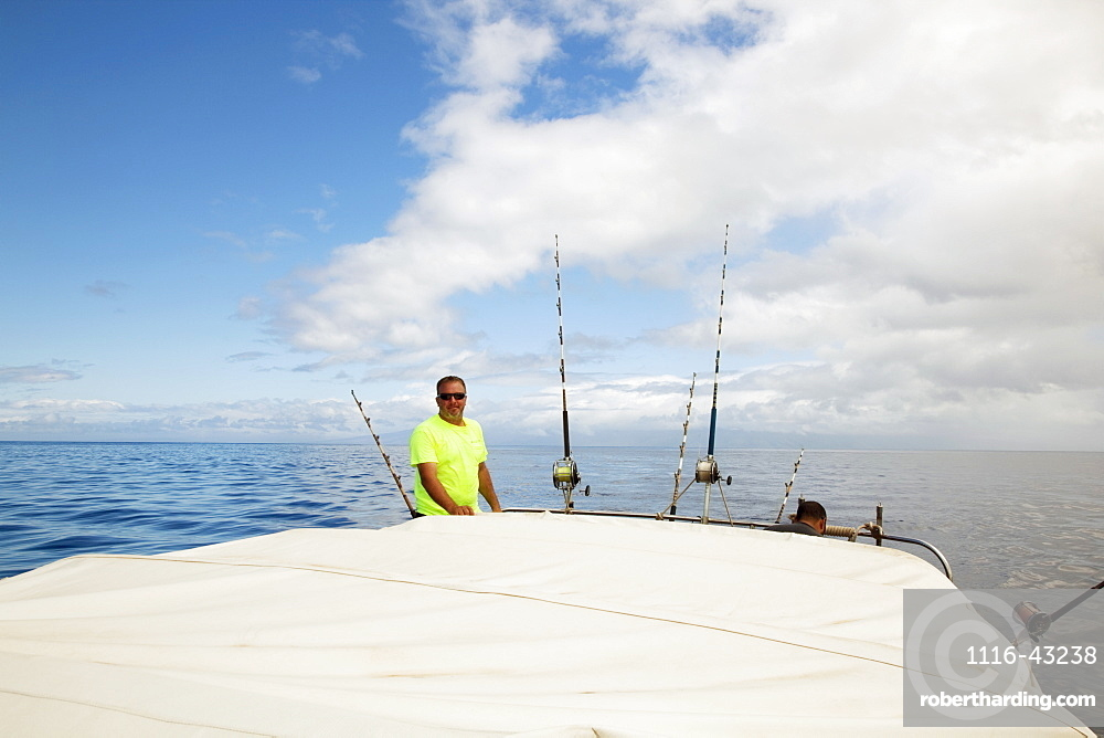 Hawaii, Maui, Man Poses With Poles On Fishing Boat