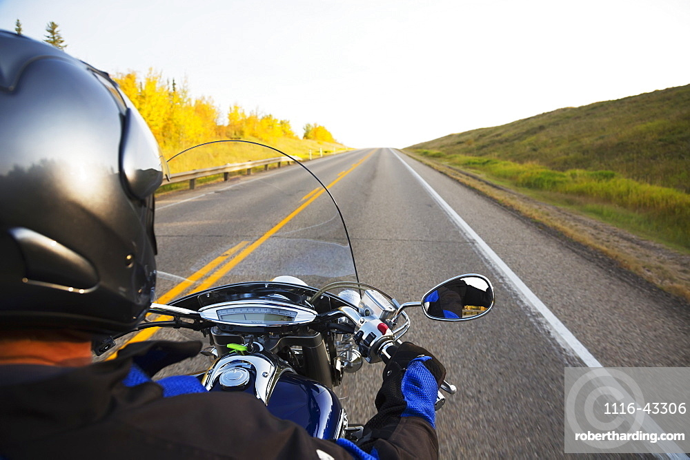 Motorcyclist Riding On The Highway, Near Edmonton, Alberta, Canada