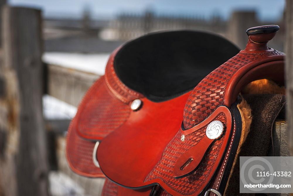 Close Up Of A Saddle On A Wooden Fence, Regina, Saskatchewan, Canada