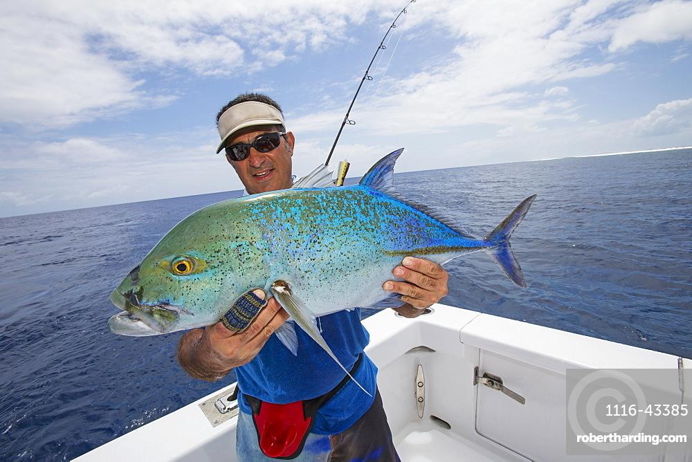 Fisherman Holding A Fresh Caught Jackfish Tuna, Tahiti