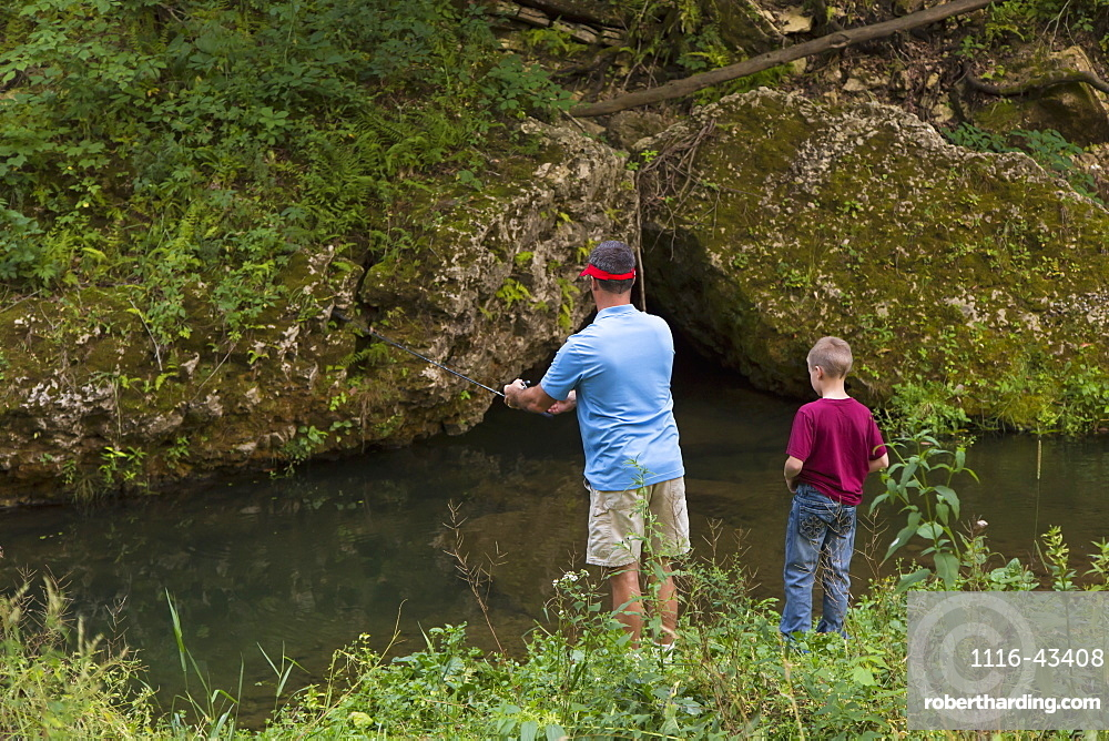 Father And Son Fishing In Bear Creek At Bixby State Preserve, Near Edgewood, Iowa, United States Of America