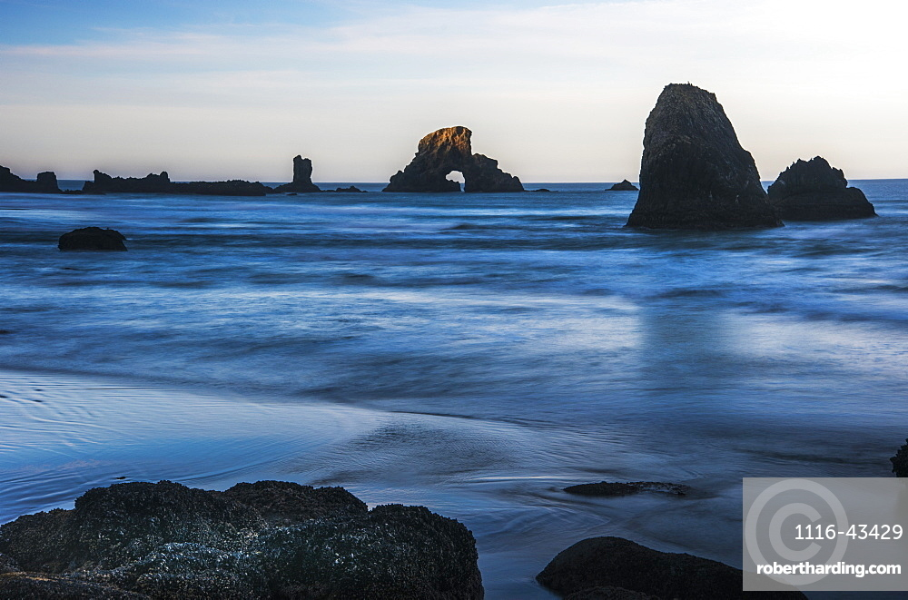 The Sun Comes Up On Sea Stacks, Cannon Beach, Oregon, United States Of America
