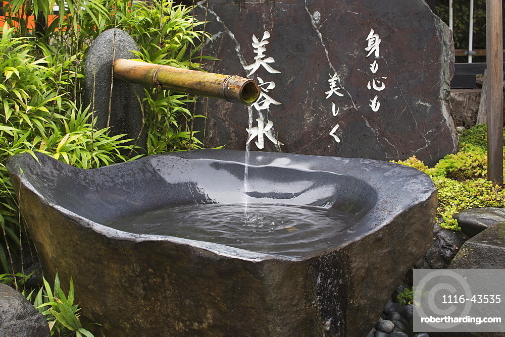 Grey Stone Water Fountain At A Japanese Temple, Kyoto, Japan