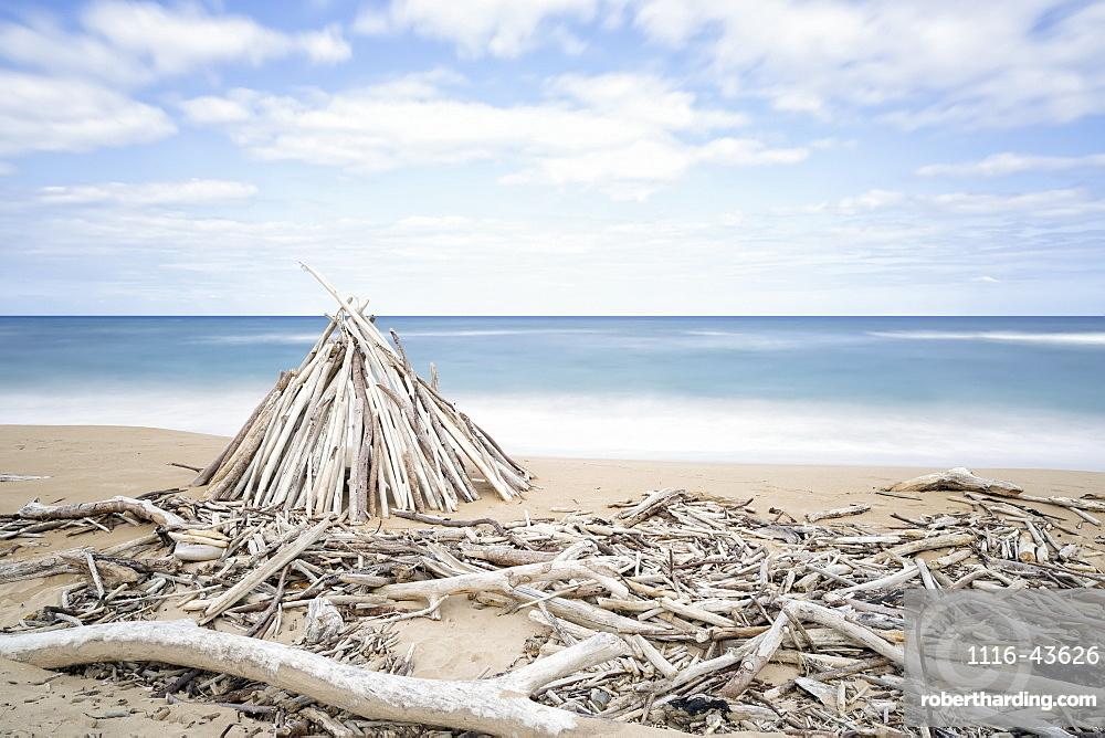 Driftwood Structures Along A Beach, Wailua, Kauai, Hawaii, United States Of America