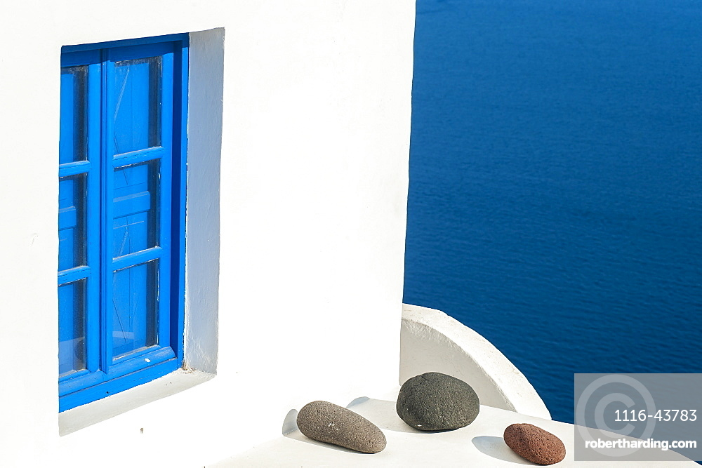Whitewash Building With Blue Trimmed Window Along The Aegean Sea, Oia, Santorini, Greece