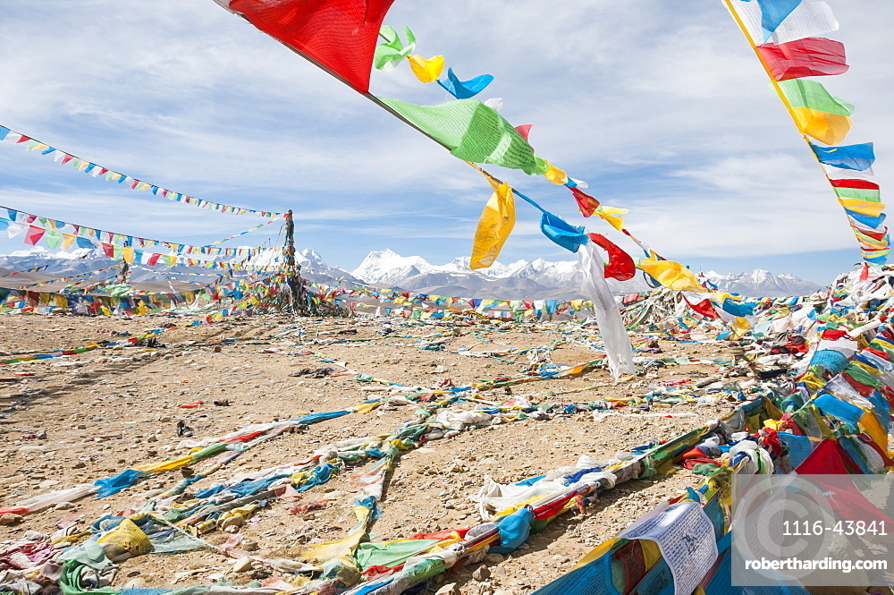 Traditional Tibetan Flags On The Mountain, Himalayas In The Background, Tibetan Friendship Highway, Tibet, China