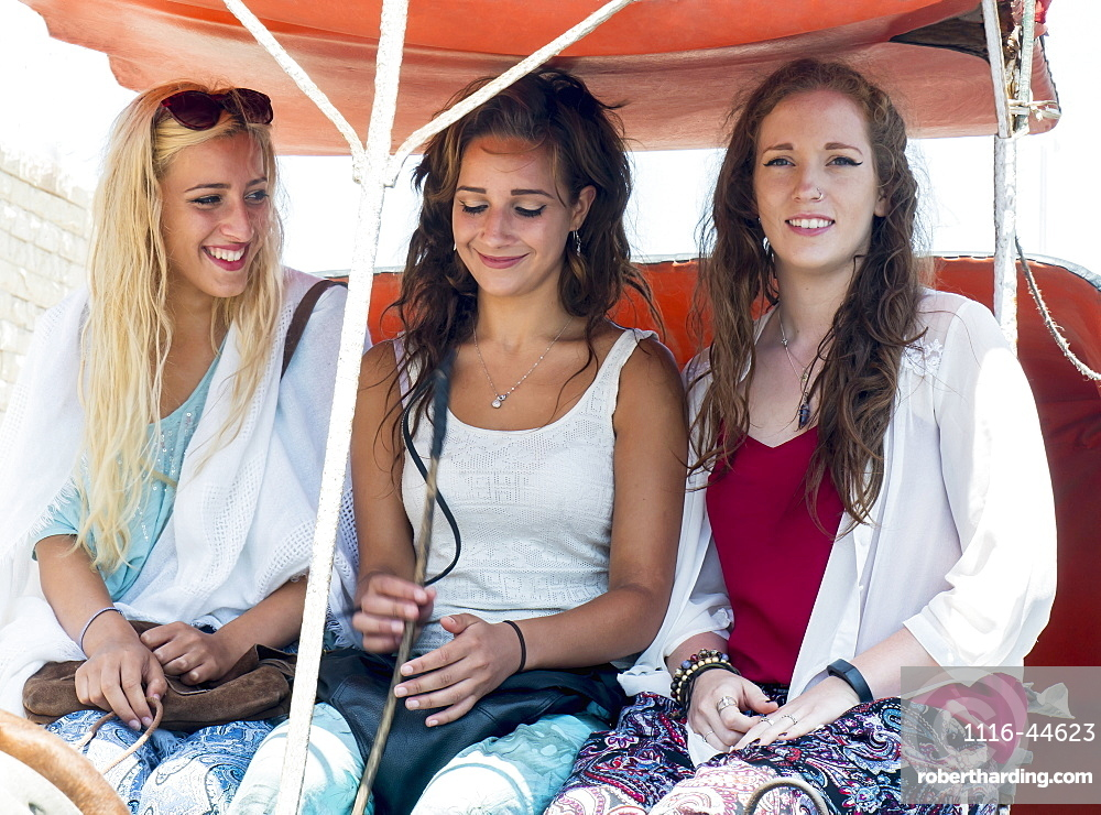 Teenage Girls Sitting Together In Caleche, Morocco