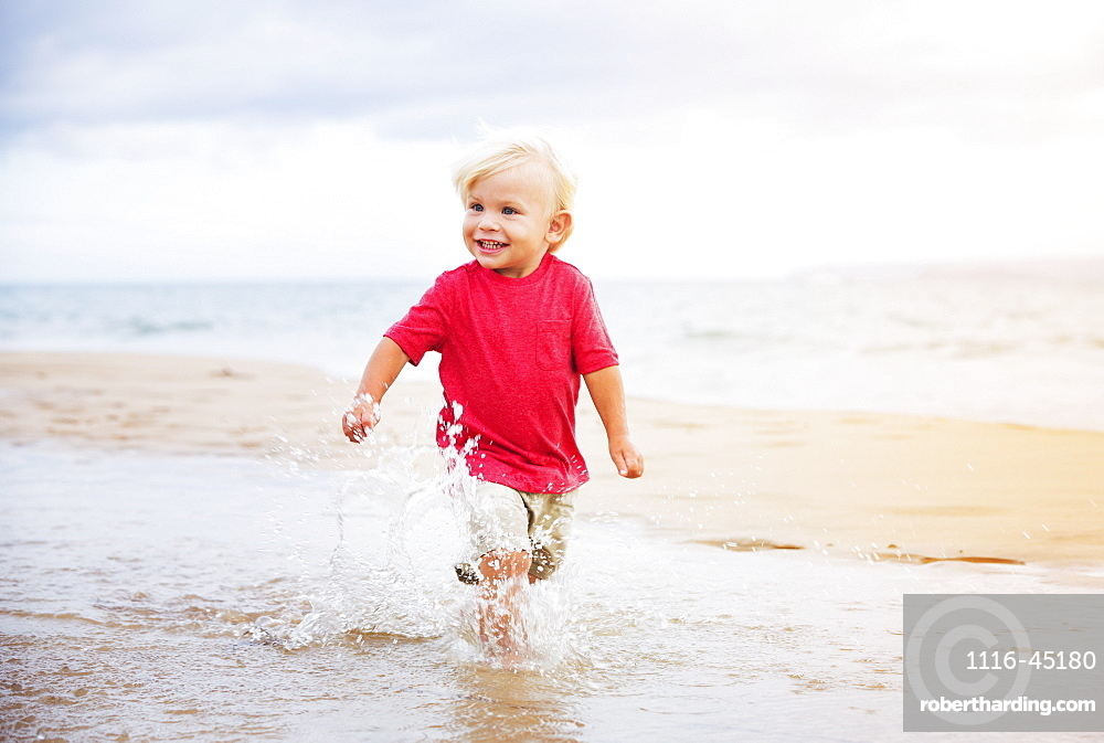 Adorable Cute Young Boy Running On The Beach