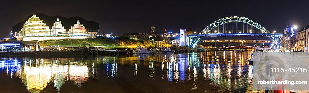 Tyne Bridge Illuminated At Nighttime Over River Tyne And Illuminated Buildings, Newcastle, Tyne And Wear, England