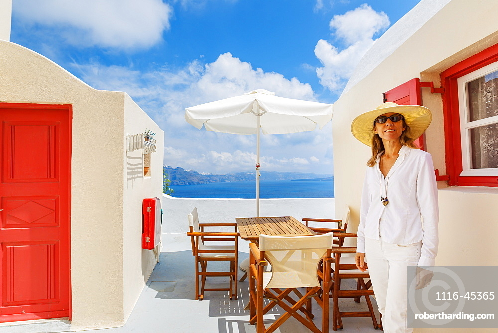 Attractive Female Tourist Relaxing On Vacation On Mediterranean Island