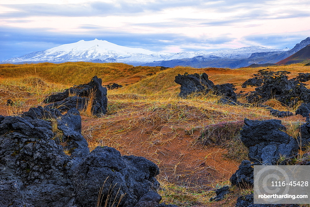 Snaefellsjokull Rises Above The Surrounding Landscape On Iceland's Snaefellsness Peninsula, With The Sunrise Lighting Up The Sky, Iceland
