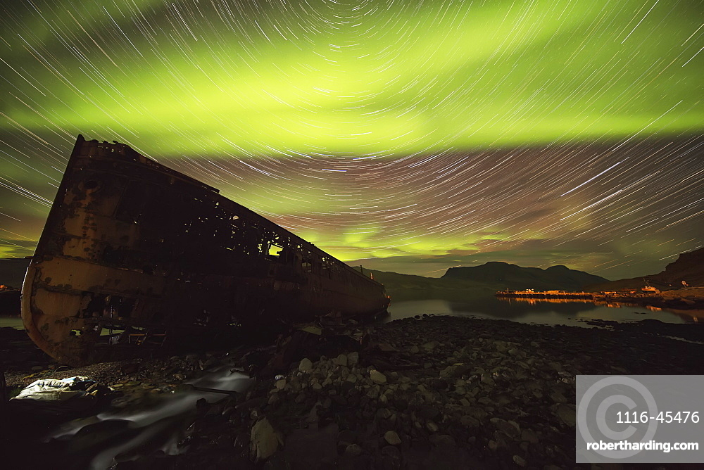 Star Trails And Northern Lights Over Top The Town Of Djupavik In The West Fjords Of Iceland, Djupavik, Iceland