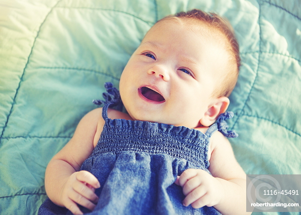Cute Newborn Baby Girl Smiling
