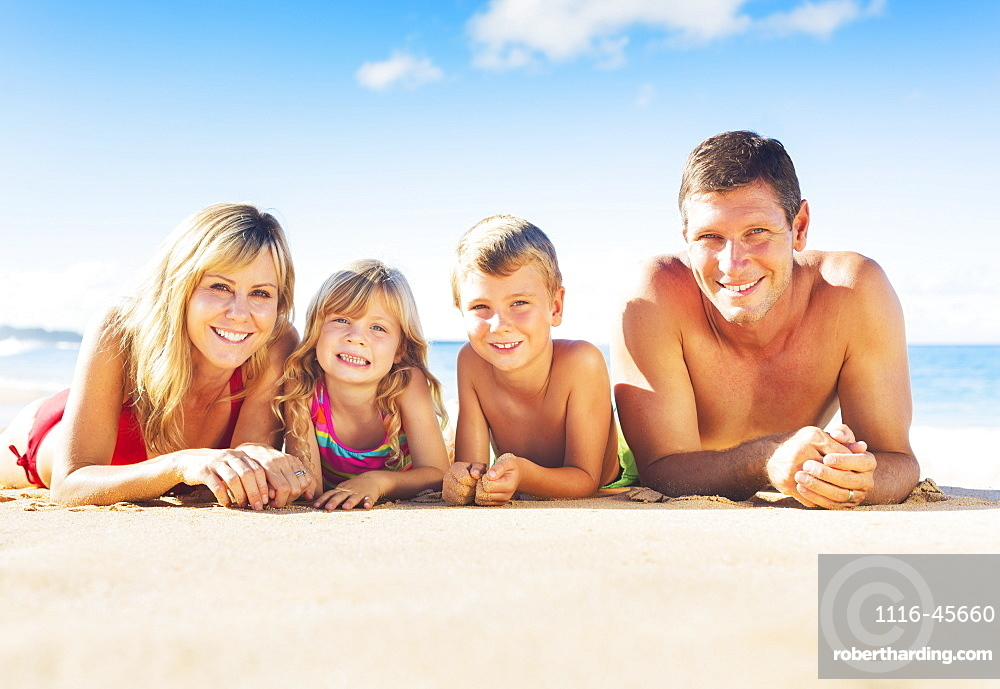 Happy Family Of Four On Tropical Beach, Summer Lifestyle
