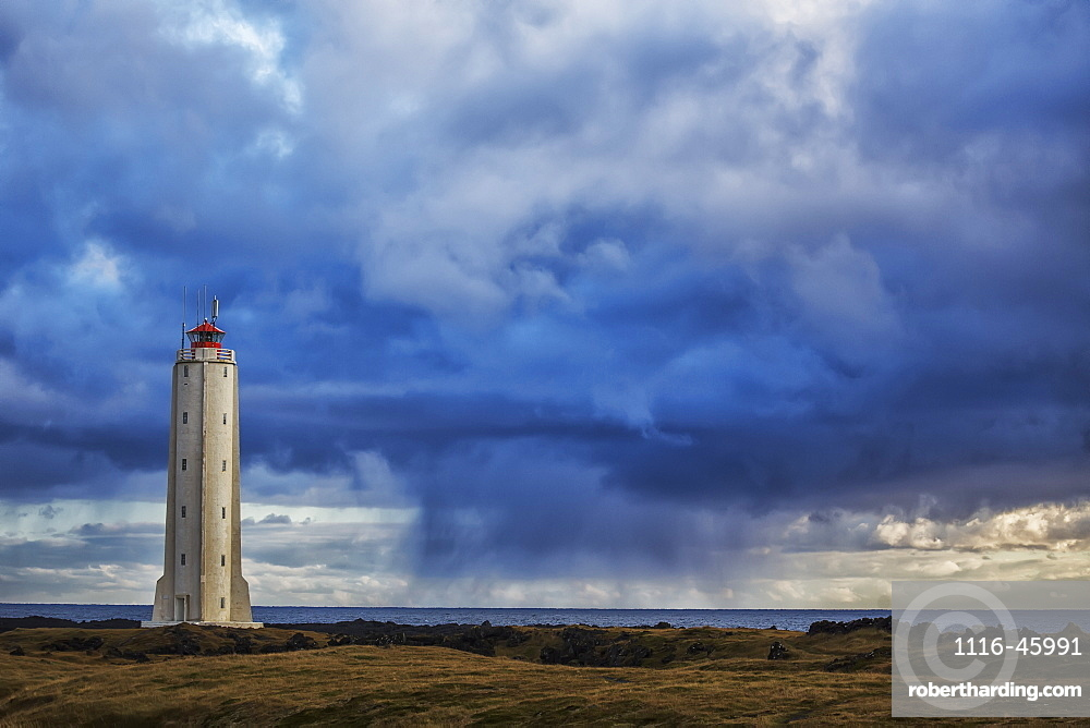 Lighthouse Known As Malarrif On The Snaefellsness Peninsula With Rain Squall Falling In The Background, Iceland