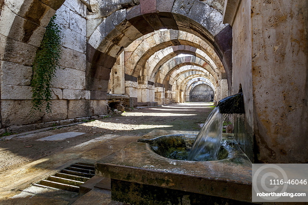 Water Flowing From A Spout In The Wall At The Site Of Ancient Ruins, Smyrna, Turkey