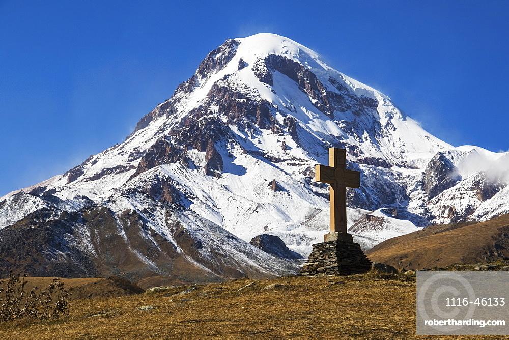 Stone Cross With Mount Kazbek In The Background, Kazbegi, Mtskheta-Mtianeti, Georgia