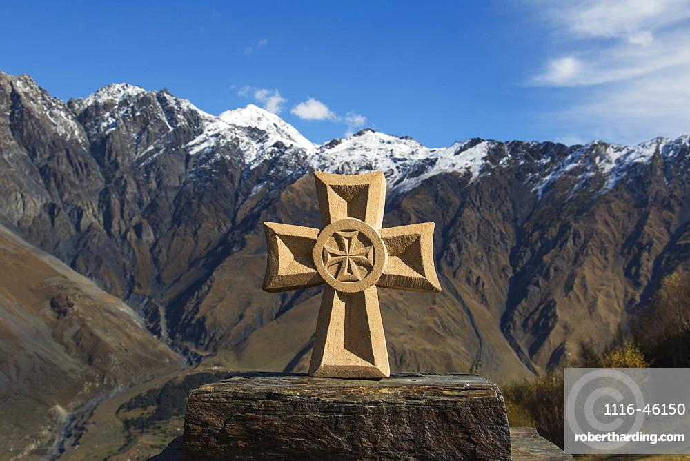 Stone Fountain With A Cross With The Caucasus Mountains In The Background, Kazbegi, Mtskheta-Mtianeti, Georgia