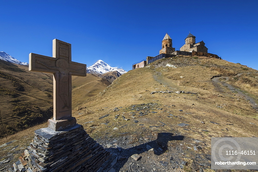 Stone Cross And Gergeti Trinity Church With Mount Kazbek In The Background, Kazbegi, Mtskheta-Mtianeti, Georgia